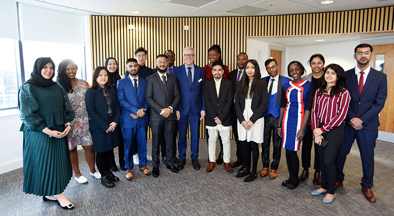 Dr David Bell with the recipients of the Vice-Chancellor's Scholarship.. Link to Dr David Bell with the recipients of the Vice-Chancellor's Scholarship..