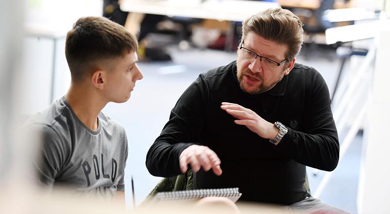 David Fox talking with design students at Teesside University.