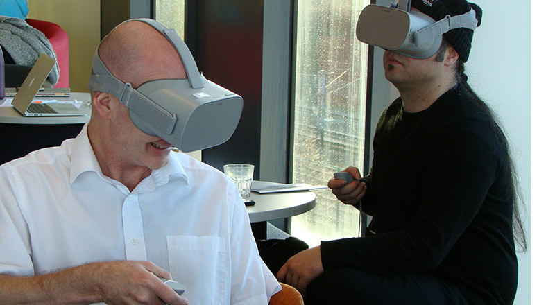 Professor Denis Martin (left) trying some of the VR technology