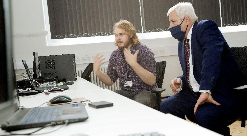 Teesside University Chancellor Paul Drechsler CBE (right)  talking to Thomas Beckensall, Creative Director of Omniplay Games Ltd.