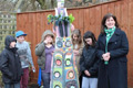 Some of the young carers with sculptor Victoria Ferrand-Scott and the totem pole.