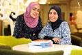 Shaima Albalooshi and Najat Bushalaibi in the University Library