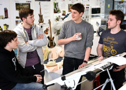 Ben Russi, centre, speaking to BA (Hons) Product design students Sam Henderson, Adam Evans and Jack Murphy.