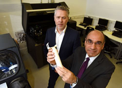 Professor Andrew Owens (left) and Professor Zulf Ali with the prototype handle.
