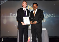 Professor Paul Croney (left) presenting Dr Pattanathu Rahman with the Enterprise Project of the Year award.