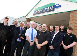 Professor Farhad Nabhani (third from left) with Sabre Rail Operations Manager Brian Capeling (fifth from left) and chief executive Stephen Thompson (third from right), along with members of staff who have completed, or are working on, qualifications at Teesside University.