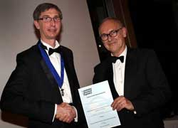 Doug Kay (left) Chairman of the Institution of Structural Engineers Northern Regions Committee, presenting the award to Barry Walmsley (right).
