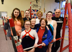 Teesside University students Leah Gibbs (back row, second left) and Kevin Gamblin (far right) with coaches and members of the Gym World Special Needs Gymnastic Team.