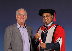 Professor James Caldwell and Satish Shewhorak
