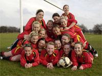 Our women's football team celebrate their success