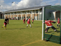 Hockey on the floodlit, artificial turf pitch