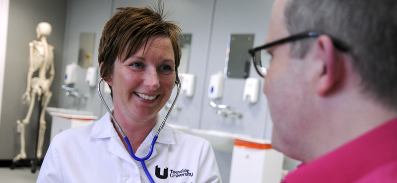 A student nurse engaged in a conversation with a care user