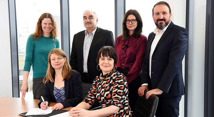 Siobhan Fenton and Kim Gauld-Clark signing the Memorandum of Understanding with staff from Teesside University and Sofia.