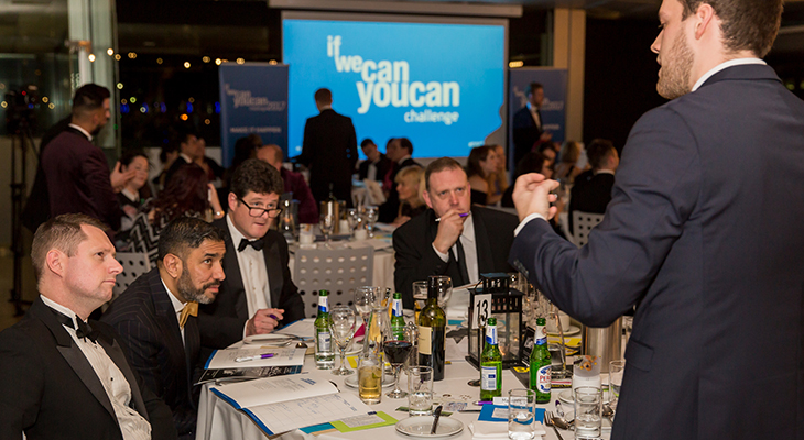 Last year's competitor Jake Newport pitching his idea to a table of business professionals including Ammar Mizar CBE.
