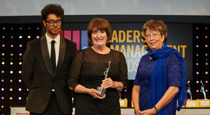 Director of Academic Enterprise Laura Woods (centre) with THELMAs host comedian Richard Ayoade (left) and Lesley Thompson, Vice-President Academic Relations at award sponsors Elsevier.