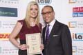 Clare Owen receiving her award from Theo Paphitis